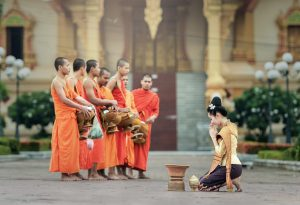 Thai Monks and a Thai lady Wai